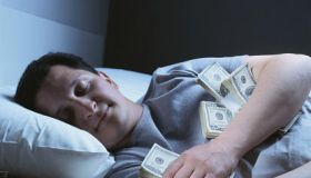 man sleeping with money