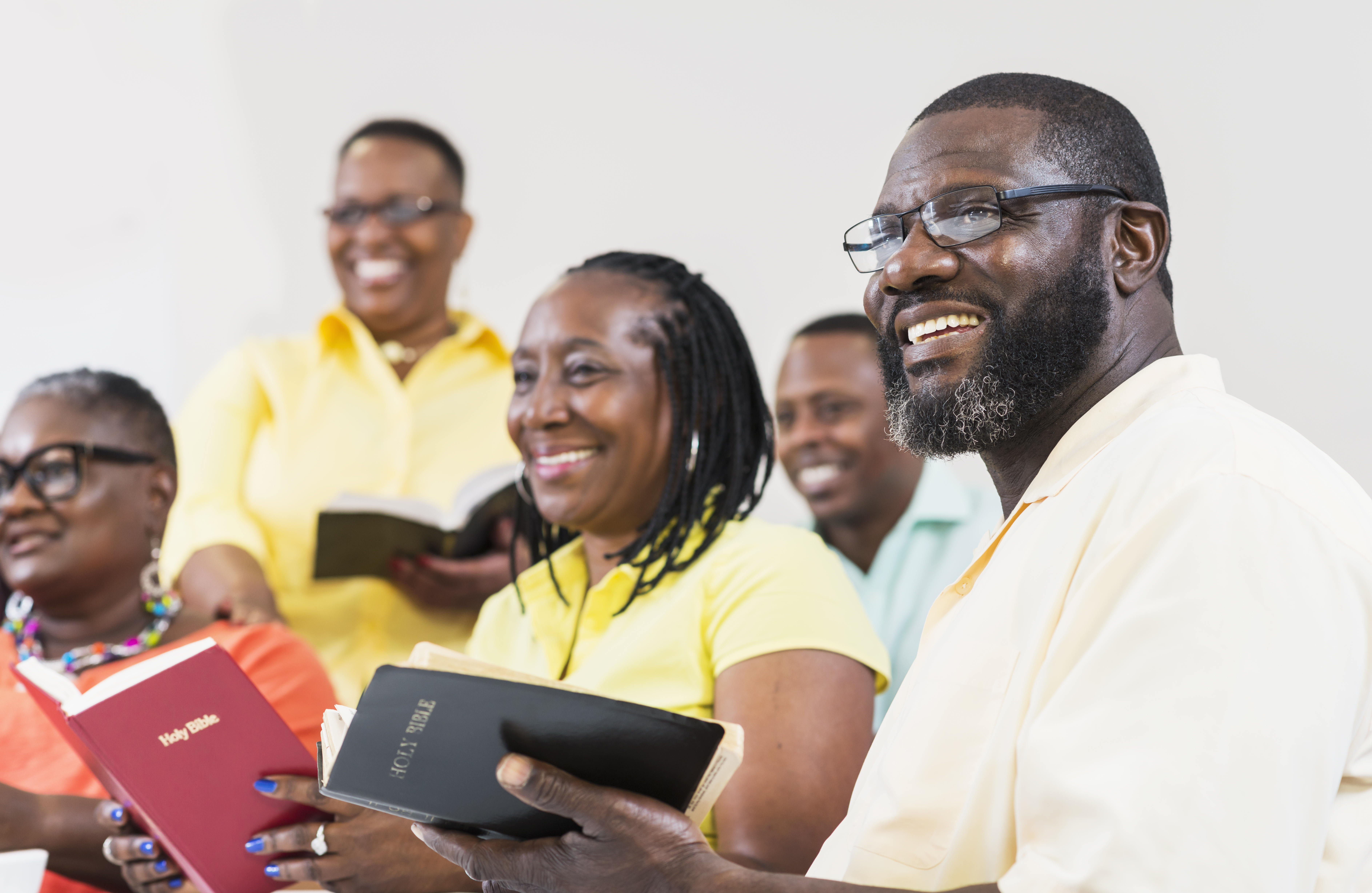 Group Of Mature Black Men And Women Holding Bibles