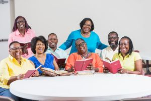 African American men and women at bible study meeting