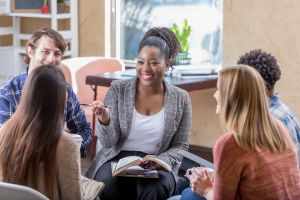 Confident African American woman leads Bible study