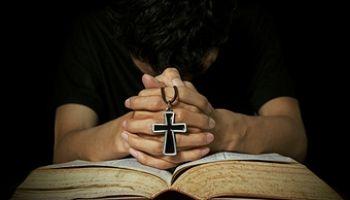 Midsection Of Man Praying