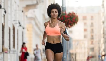 Young athletic woman running outdoors