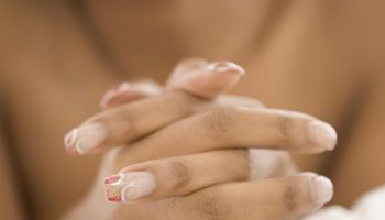 Close up of African woman's manicure