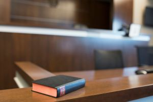 Bible on witness stand in empty courtroom