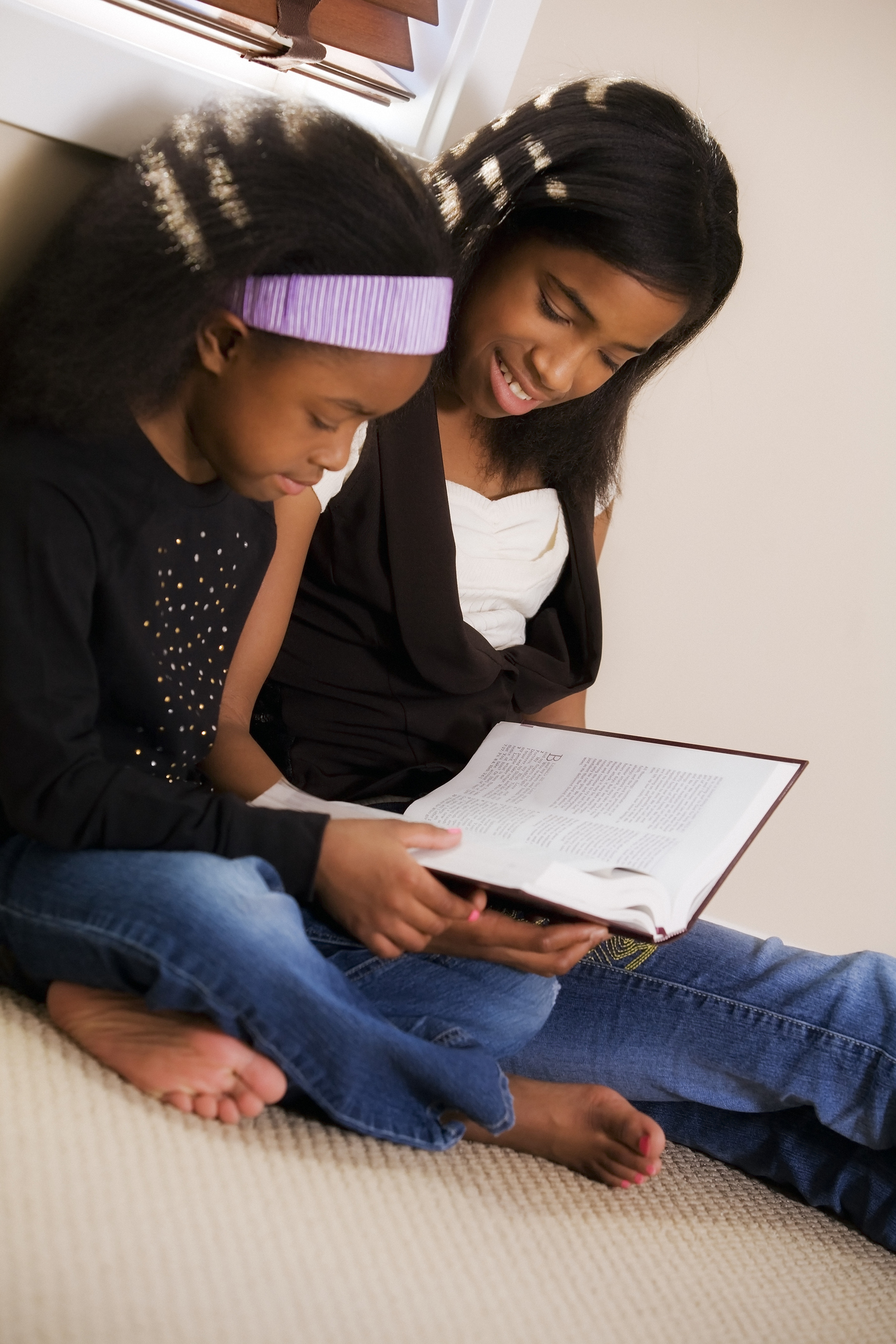Sisters reading the Bible