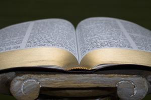 An open Bible on a pedestal