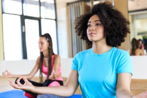 Woman practicing yoga in gym