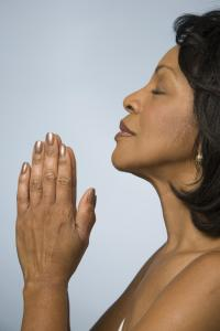 Profile of mature woman praying, close-up