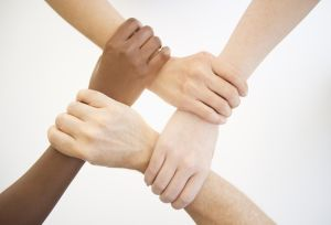 Four hands holding wrists of other people
