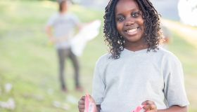 Beautiful African American girl helps with community cleanup