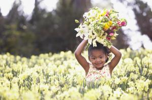 African American girl in field of spring flowers