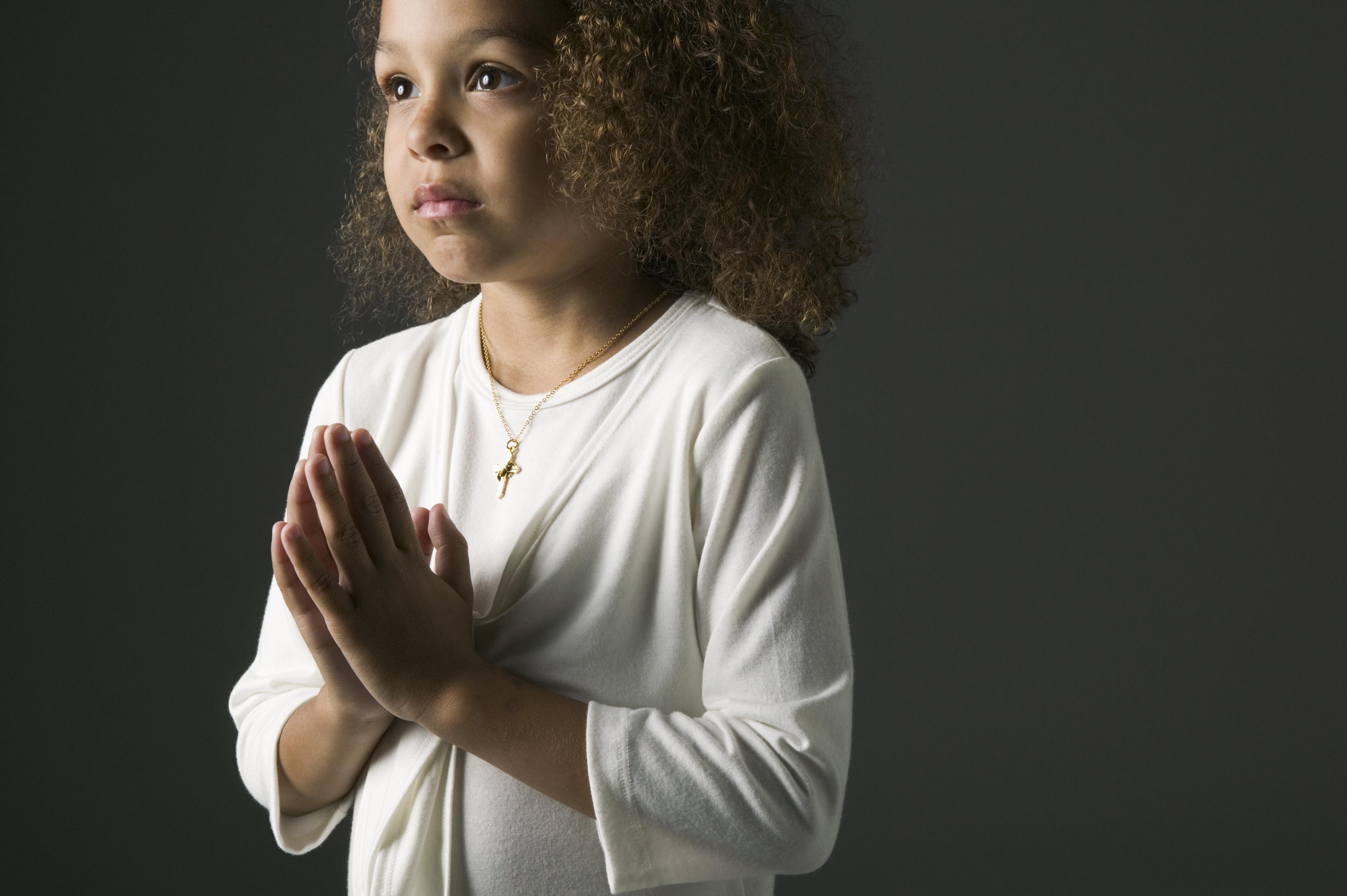 Young African girl praying