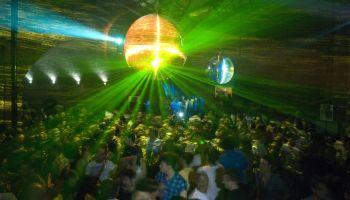 Mirrorball reflecting lights above crowded dancefloor. Secretsundaze at Village Underground, Shoreditch. London 26.07.09