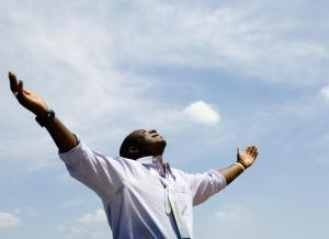 Young African Businessman with his Arms Outstretched