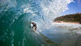 Surfer tuberiding a wave, Brighton Beach, Durban, Kwazulu Natal, South Africa