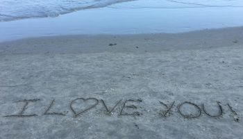 High Angle View Of I Love You Text On Shore At Beach