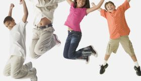 Studio shot of children jumping