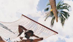 Man Sleeping on a Hammock on a Beach